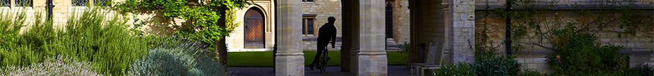Cyclist riding through trio of arches