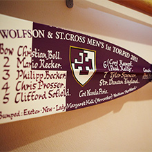Rowing oar with team names written on paddle